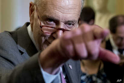 Senate Minority Leader Sen. Chuck Schumer of N.Y. calls on a reporter following a closed-door Democratic policy meeting, at the Capitol in Washington, Sept. 25, 2018.