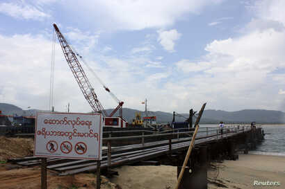 FILE - A small port is built for temporary use at a site for a billion-dollar industrial estate in Dawei district in Myanmar, May 10, 2012.