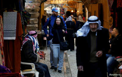 A member of the Temporary International Presence in Hebron (TIPH) gestures as she walks in the old city of Hebron, in the Israeli-occupied West Bank, Jan. 29, 2019.