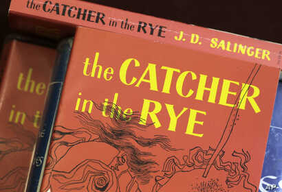 "FILE - Copies of J.D. Salinger's classic novel ""The Catcher in the Rye"" are seen at the Orange Public Library in Orange Village, Ohio, Jan. 28, 2010."