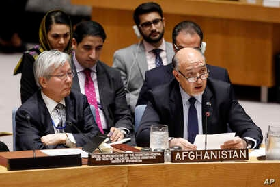 United Nations envoy for Afghanistan Tadamichi Yamamoto, left, listens as Afghanistan's U.N. Ambassador Mahmoud Saikal addresses the United Nations Security Council, at U.N. headquarters, Monday, Sept. 17, 2018.