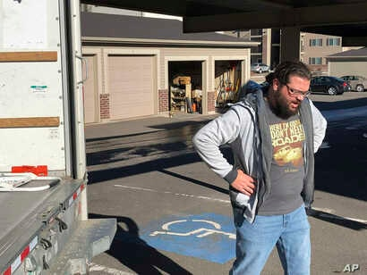 George Jankowski, a furloughed U.S. Department of Agriculture worker, helps a friend move out of an apartment in Cheyenne, Wyoming, Jan. 14, 2019.