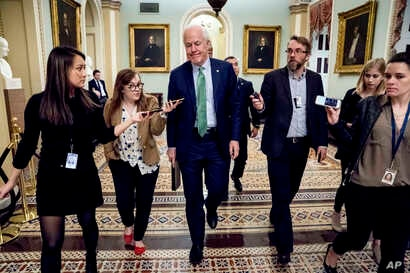 Senate Majority Whip Sen. John Cornyn, R-Texas, speaks to reporters as he walks to the Senate Chamber at the Capitol in Washington, Monday, Jan. 22, 2018, after the Senate reached an agreement to advance a bill ending government shutdown.