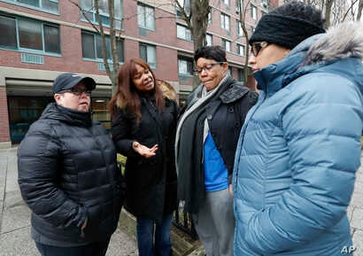 Residents of a HUD Section 8 apartment complex, from left, Kristen Pearson, Tenants Association President Eneaqua Lewis, Charmell Shaw and Yitza Martinez discuss financial issues and the impact the government shutdown could have on their lives during...