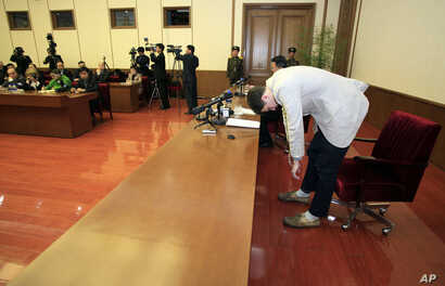 American student Otto Warmbier, right, bows as Warmbier is presented to the reporters on Monday, Feb. 29, 2016.