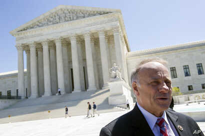 Rep. Steve King, R-Iowa speaks with reporters in front of the Supreme Court in Washington.