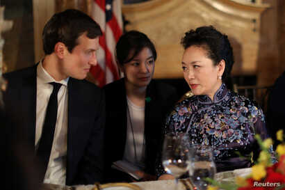 China's first lady Peng Liyuan talks with Trump Senior Adviser Jared Kushner as they attend a dinner at the start of a summit between U.S. President Donald Trump and Chinese President Xi Jinping at Trump's Mar-a-Lago estate in West Palm Beach, Florid...