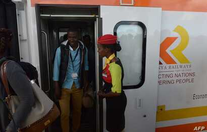 FILE - Passengers disembark upon arrival in a Mombasa-to-Nairobi train launched to operate on the Standard Gauge Railway (SGR), May 31, 2017.