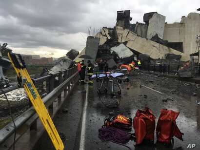 Cars are blocked on the Morandi highway bridge after a section of it collapsed, in Genoa, northern Italy, Aug. 14, 2018. A large section of the bridge collapsed over an industrial area in the Italian city during a sudden and violent storm, leaving ve...