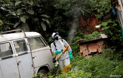 A State Endemics Control health agent fumigates insecticide in an area to kill mosquitoes during a campaign against yellow fever in Sao Paulo, Brazil, Jan. 17, 2018.