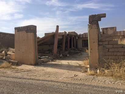 In villages like this one, besides being looted and booby-trapped, many homes and businesses, like this former bank of shops, have been destroyed, in Kazir province of Kurdistan in Iraq, Oct. 22, 2016. (H. Murdock/VOA)