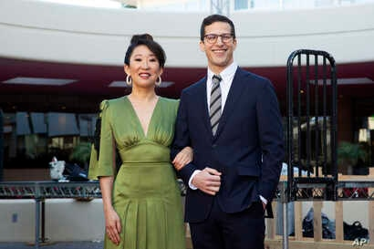 Sandra Oh, left, and Andy Samberg pose for a photo on the red carpet at the 76th Annual Golden Globe Awards Preview Day at The Beverly Hilton on Jan. 3, 2019, in Beverly Hills, California. The pair will host Sunday's event.