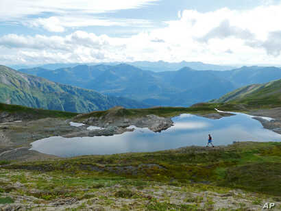FILE -- A hiker on the Juneau ridge in Juneau, Alaska, a state many home buyers left in 2018 in favor of Washington State.