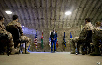 U.S. Defense Secretary Ash Carter talks to U.S. and Jordanian forces at a Jordanian air base, July 21, 2015.