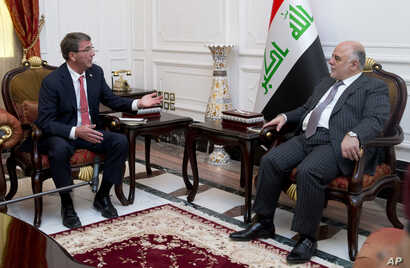 FILE - U.S. Defense Secretary Ash Carter meets with Iraqi Prime Minister Haider al-Abadi in the prime minister's office in Baghdad, Iraq, July 23, 2015.