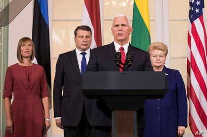 U.S. Vice President Mike Pence, second from right, accompanied by the leaders of Baltic states, from left, Estonian President Kersti Kaljulaid, Latvian President Raimonds Vejonis and Lithuanian President Dalia Grybauskaite, speaks during a news confe...