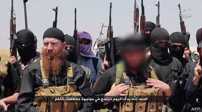 An image made available by Jihadist media outlet al-Itisam Media on June 29, 2014, allegedly shows members of the Islamic State, including military leader and Georgia native, Abu Omar al-Shishani (Tarkhan Batirashvili) (C-L) and ISIL sheikh Abu Moham...
