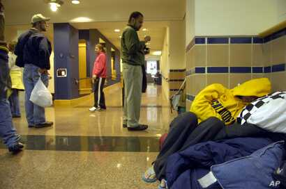 Rachel Blake, right, sleeps in the hallway of Hall Memorial Building on the campus of Gallaudet University on Friday, October 6, 2006, in Washington, DC.
