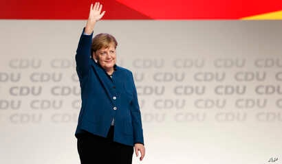 German Chancellor and chairwoman of the German Christian Democratic Union (CDU), Angela Merkel, waves after her farewell speech during a party convention of the CDU in Hamburg, Germany, Dec. 7, 2018.