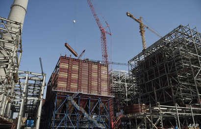 A general view of a Chinese-backed power plant under construction, May 23, 2018, in Islamkot in the desert in the Tharparkar district of Pakistan's southern Sindh province.