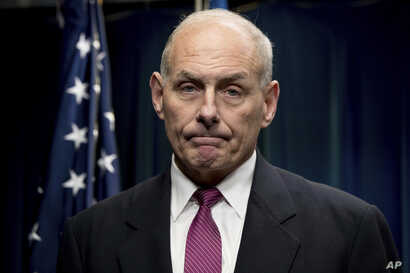 FILE -  Homeland Security Secretary John Kelly pauses while speaking at a news conference at the U.S. Customs and Border Protection headquarters in Washington.