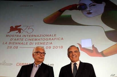 Venice Film Festival director Alberto Barbera, right, and Paolo Baratta, president of the arts organization Venice Biennale, pose for photographers on the occasion of the official presentation of the 75th edition of the festival in Rome, July 25, 201...