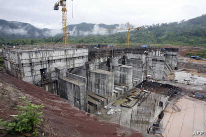 FILE - The regulating dam of the Nam Theun 2 power dam under construction is pictured in this 28 June 2007 photo, in Lao's Nakai plateau.