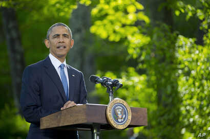 President Barack Obama listens during a news conference after meeting with Gulf Cooperation Council leaders and delegations at Camp David in Maryland, May 14, 2015.