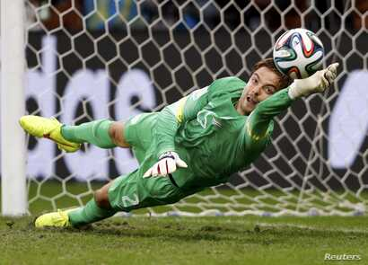 Goalkeeper Tim Krul of the Netherlands saves the last penalty shot against Costa Rica during a penalty shootout in their quarter-finals at the Fonte Nova arena in Salvador, July 5, 2014.