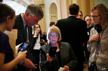 Sen. Patty Murray, D-Wash., looks at a cellphone while speaking with a journalist after she and other members of the Senate Democratic leadership spoke to reporters about health care on Capitol Hill in Washington, May 9, 2017.