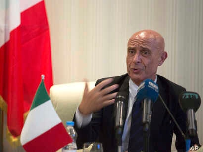 Italian Interior Minister Marco Minniti speaks during a meeting with Libyan Interior Minister Al-Arif Saleh Al-Khoja and the mayors of Libyan municipalities, to discuss the problem they face with migrants attempting to cross the Mediterranean Sea, Ju...