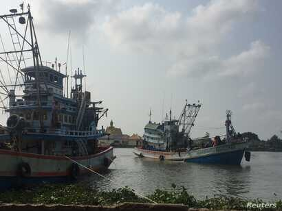 A fishing boat pulls into a port in Samut Sakhon, Thailand, March 25, 2018.
