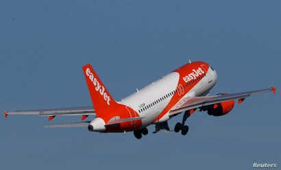 FILE PHOTO: A Easy Jet Airbus A319-100 plane takes off from the Nantes-Atlantique airport in Bouguenais near Nantes, France, Feb. 12, 2019.