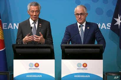Singapore's Prime Minister Lee Hsien Loong, left, and Australia's Prime Minister Malcolm Turnbull hold a joint press conference at the end of the Association of Southeast Asian Nations (ASEAN) special summit, in Sydney, March 18, 2018.