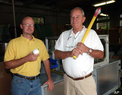 FILE - David J. Mullany, left, and his father, David A. Mullany, pose at the Wiffle Ball factory in Shelton, Conn., Aug. 7, 2003. The family business observed its 50th anniversary that year.