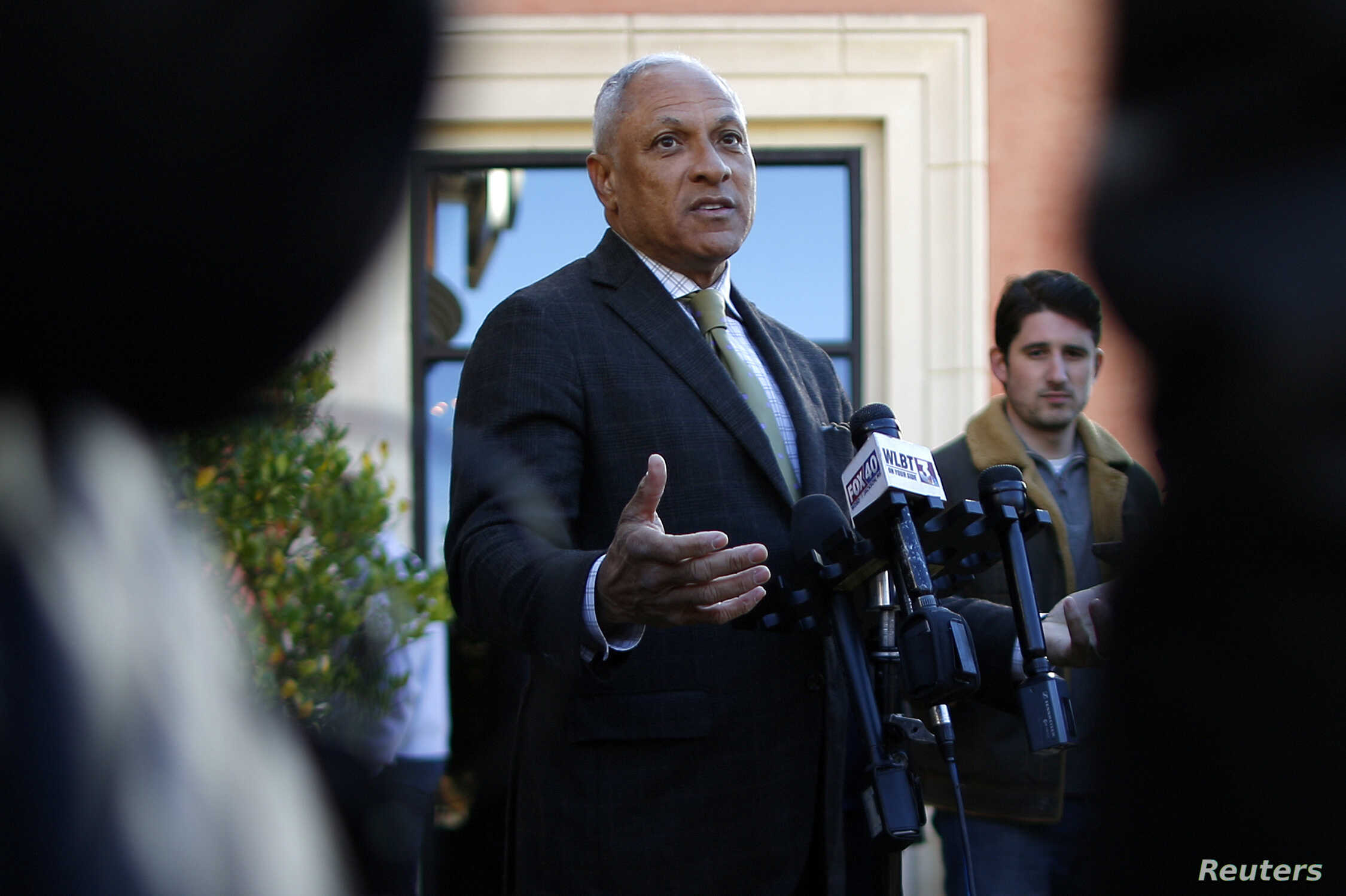 U.S. Senate candidate Mike Espy takes an interview with media during a news conference in Jackson, Mississippi, Nov. 26, 2018.