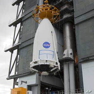 The Mars Science Laboratory, bolted inside the payload fairing of an Atlas V rocket, is hoisted into place at Launch Complex 41 at Cape Canaveral Air Force Station in Florida.