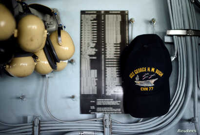 A crew member's hat hangs inside Primary Flight Control of the USS George H.W. Bush aircraft carrier anchored off Stokes Bay in the Solent, Britain, July 27, 2017.