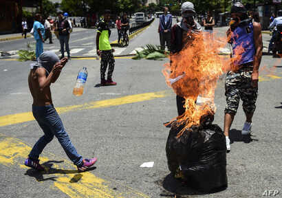 Anti-government activists demonstrate against Venezuelan President Nicolas Maduro at a barricade set up on a road in Caracas on Aug. 8, 2017.