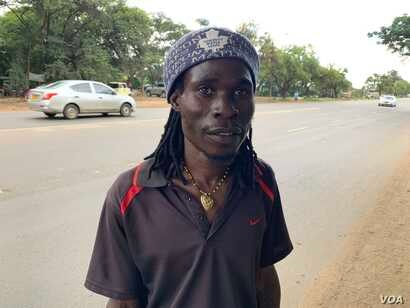Simbai Rice, one of the demonstrators gathered in Harare, Jan. 14, 2019, says President Emmerson Mnangagwa's administration has failed to address increasing shortages of cash and basic food items.
