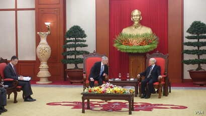 U.S. Defense Secretary Jim Mattis leans in to listen to Vietnamese Communist Party chief Nguyen Phu Trong at the party's headquarters in Hanoi, Vietnam, Jan. 25, 2018.