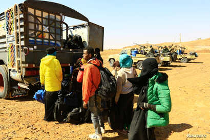 Illegal immigrants and traffickers are caught while travelling in a remote desert area en route to Libya, at Omdurman, Sudan Jan. 8, 2017.