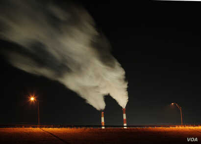 Smoke rising from the stacks of the La Cygne Generating Station coal-fired power plant in La Cygne, Kansas.
