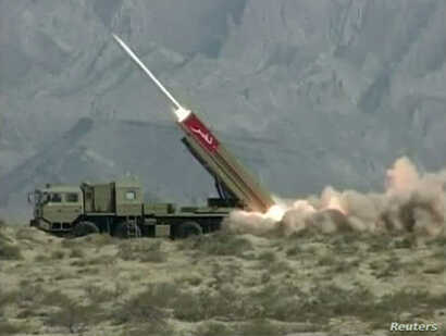 FILE - This still image from a Pakistan military handout video shows a NASR (Hatf IX) missile being fired during a test at an undisclosed location in Pakistan, April 19, 2011.