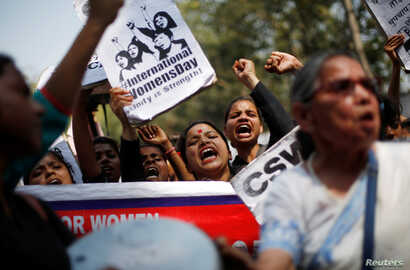 Girls shout slogans during a protest demanding equal rights for women on the occasion of International Women's Day in New Delhi, India, March 8, 2018.