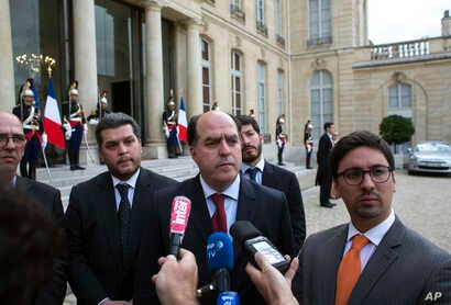 President of the Venezuelan parliament, Julio Borges, center, vice president of the Venezuelan parliament, Freddy Guevara, right, and Venezuelan deputy Eudoro Gonzalez, center left, speak to the press after a meeting with France's President Emmanuel ...