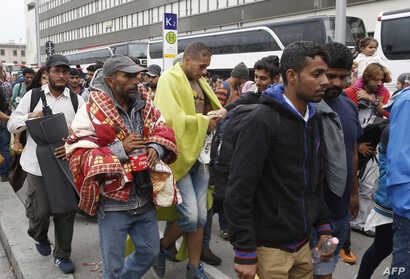 Migrants arrive at the Westbahnhof railroadstation in Vienna, on September 5, 2015  as hundreds of migrants arrive by bus and train from Hungary to continue their journey to Germany.