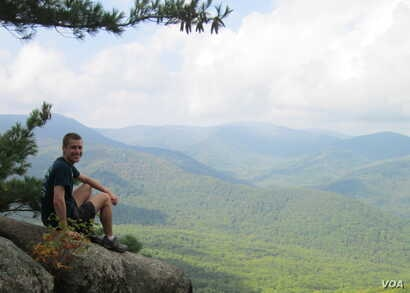 Sitting on rock: Hiking toward the top of Old Rag Mountain in Shenandoah National Park in October 2014.