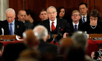 FILE - Senate Judiciary Committee Chairman Sen. Charles Grassley, R-Iowa, (C), flanked by the committee's ranking member, Sen. Dianne Feinstein, D-Calif., (R), and Sen. Orrin Hatch, R-Utah, questions Attorney General-designate, Sen. Jeff Sessions, R-...