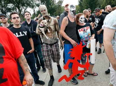 """Juggalos, as supporters of the rap group Insane Clown Posse are known, gather in front of the Lincoln Memorial in Washington during a rally, Sept. 16, 2017, to protest and demand that the FBI rescind its classification of the juggalos as """"loosely org..."""